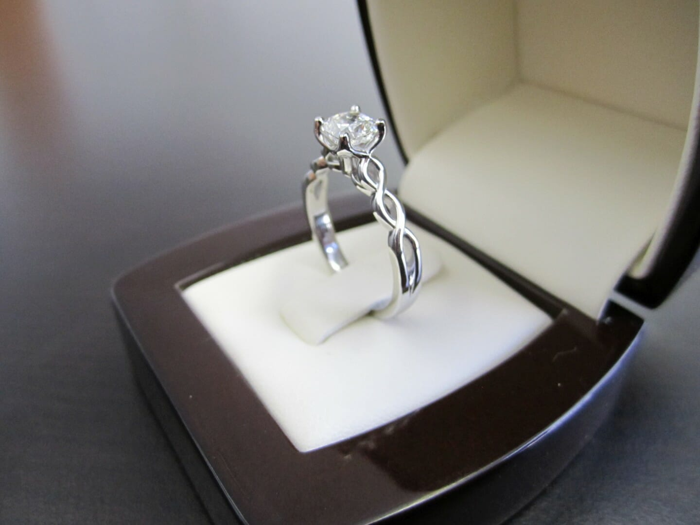 Picture of 1ct Cushion Brilliant Diamond in a Platinum Twist Design Engagement Ring