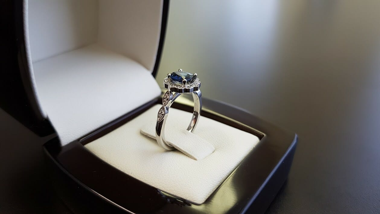 Picture of Blue Sapphire Center Gemstone in a Halo Engagement Ring